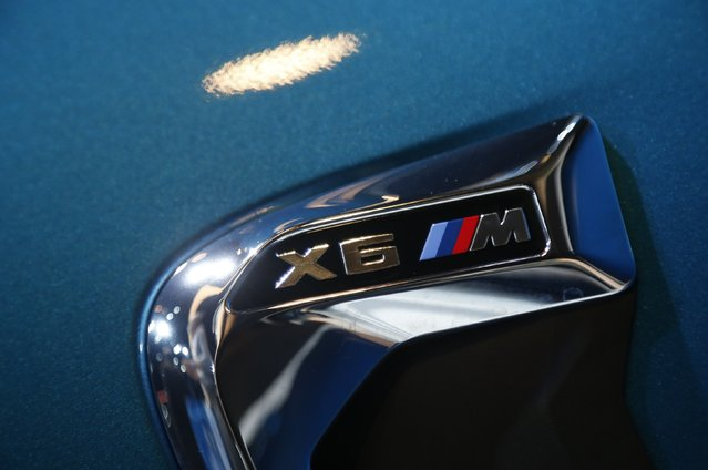 The badge of the BMW X6M is shown during the model's world debut at the Los Angeles Auto Show in Los Angeles, California November 19, 2014. (Photo by Lucy Nicholson/Reuters)