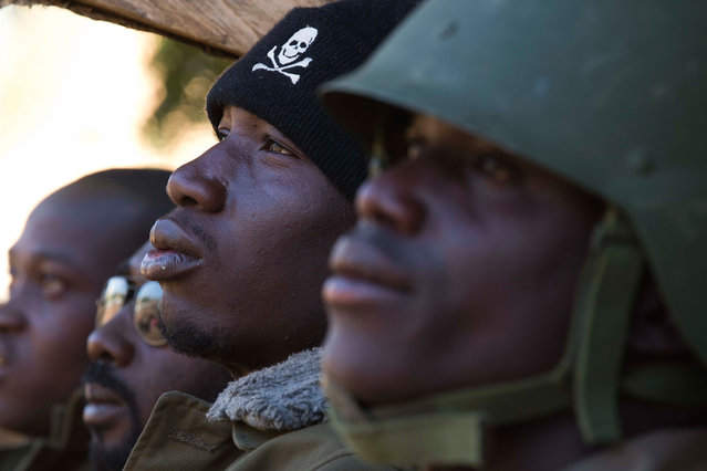 A Malian soldier is pictured near the market in Gao, on February 22, 2013. Five people, including two suicide bombers, died Friday in car bombings in northern Mali, a day after fierce urban battles between French-led forces and Islamists left up to 20 extremists dead, officials said. (Photo by Joel Saget/AFP Photo/The Atlantic)