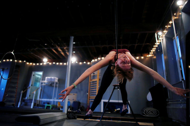 Molly Plunk trains on the tightrope wire at the Aloft Loft circus training and teaching school which was converted from a church, in Chicago, Illinois, U.S., September 20, 2016. (Photo by Jim Young/Reuters)