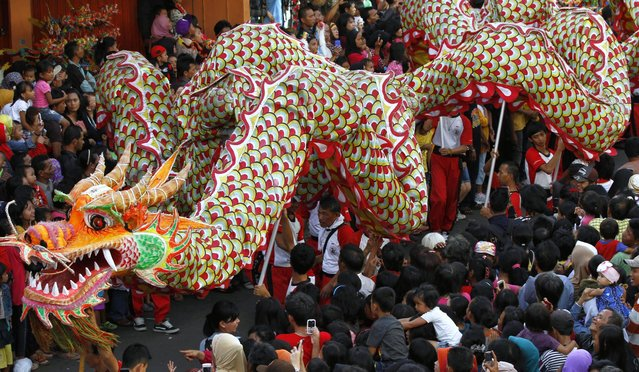 People perform a dragon dance during a cultural festival marking the end of Chinese New Year celebrations in Bogor, West Java, Indonesia, Wednesday, March 13, 2013. (Photo by Achmad Ibrahim/AP Photo)