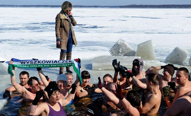 Ice swimmers enjoy a bath in the frigid water of the Zegrzynski lake in Nieporet, near Warsaw, Poland, on March 17, 2013. (Photo by Alik Keplicz/Associated Press)