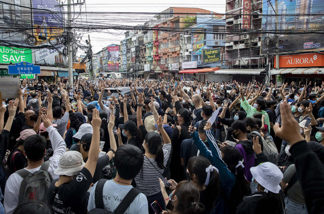 Pro-democracy protesters flash three-fingered salute during a protest in Udom Suk, suburbs of Bangkok, Thailand, Saturday, October 17, 2020. The authorities in Bangkok shut down mass transit systems and set up roadblocks Saturday as Thailand's capital faced a fourth straight day of determined anti-government protests. (Photo by Gemunu Amarasinghe/AP Photo)