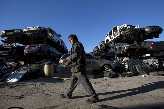 A worker walks through a junkyard in the Willets Point area of Queens in New York October 30, 2015. (Photo by Andrew Kelly/Reuters)