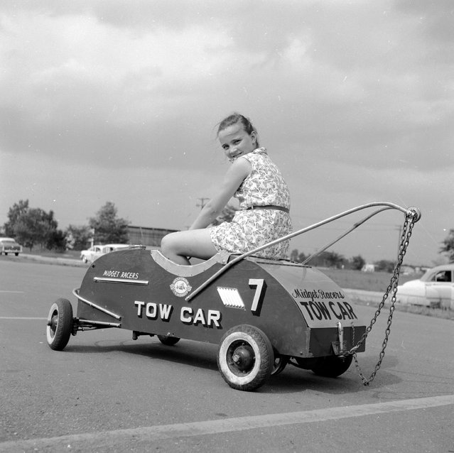 "A tow car for the children's  ""Grand Prix"" races which take place in a parking lot in Livonia, Michigan a suburb of Detroit, circa 1955. (Photo by Three Lions/Getty Images)"