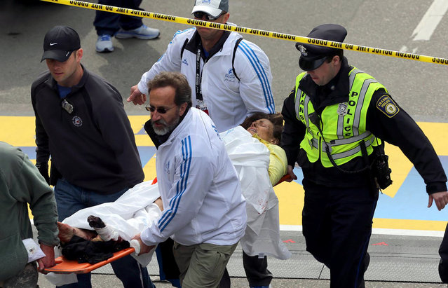 Medical workers aid injured people at the finish line of the 2013 Boston Marathon following an explosion in Boston, Monday, April 15, 2013. (Photo by David L. Ryan/AP Photo/The Boston Globe)