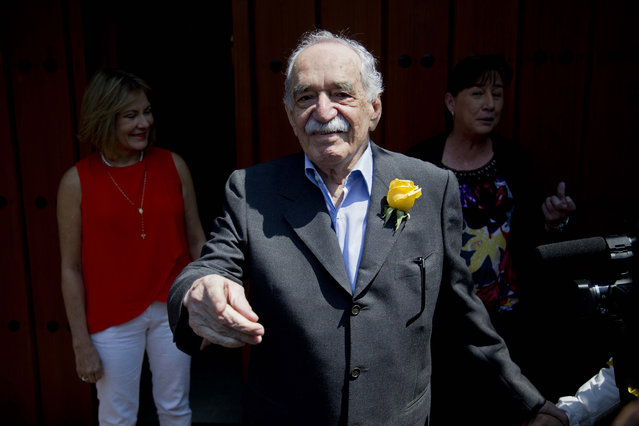 In this March 6, 2014 file photo, Gabriel Garcia Marquez greets fans and reporters outside his home on his birthday in Mexico City. The Colombian Nobel Literature laureate died this year on April 17. His flamboyant and melancholy works outsold everything published in Spanish except the Bible, and he is considered the most popular Spanish-language writer since Miguel de Cervantes in the 17th century. (Photo by Eduardo Verdugo/AP Photo)