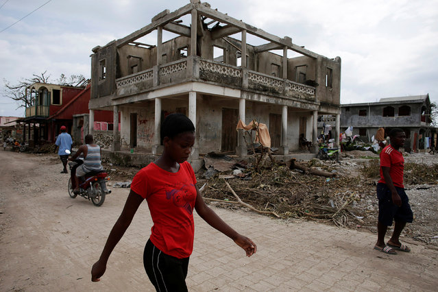 People walk after Hurricane Matthew in a street of Port-a-Piment, Haiti, October 9, 2016. (Photo by Andres Martinez Casares/Reuters)