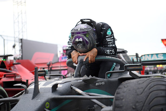 Mercedes' British driver Lewis Hamilton reacts as he gets out of his car after winning the Turkish Formula One Grand Prix at the Intercity Istanbul Park circuit in Istanbul on November 15, 2020. Lewis Hamilton won the race to seal his 7th World Championship. (Photo by Clive Mason/Pool via AFP Photo)