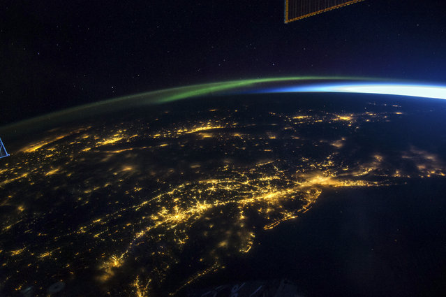 Large concentrations of light reveal the major cities located on the East coast of USA seen at night, on board the International Space Station on August 06, 2014. (Photo by NASA/SPL/Barcroft Media)