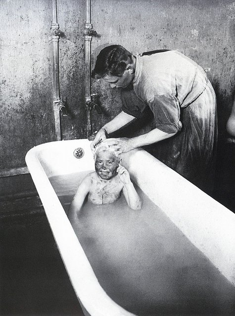 Bathing Homeless, 1927. Born into rural poverty in 1898, Arkady Shaikhet was just 19 years old when the Russian Revolution shook the world. After serving in the war, he honed his technique of 'artistic reportage' to document the building of the USSR, and founded the magazine Soviet Photo in 1927. (Photo by Arkady Shaikhet/Lumiere Brothers Center for Photography)
