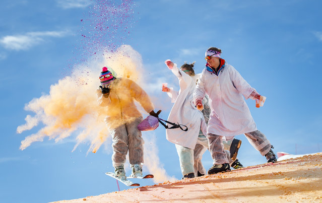 Skiers take part in the Skicolor event where they are sprayed with biodegradable color powders as part of carnival celebrations in the alpine resort of La Tzoumaz, Switzerland, 23 February 2020. (Photo by Valentin Flauraud/EPA/EFE)