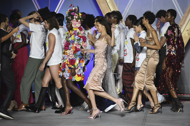 Model Bella Hadid, centre, walks the runway with other models at the end of the Fashion For Relief 2018 event during the 71st international film festival, Cannes, southern France, Sunday, May 13, 2018. (Photo by Arthur Mola/Invision/AP Photo)