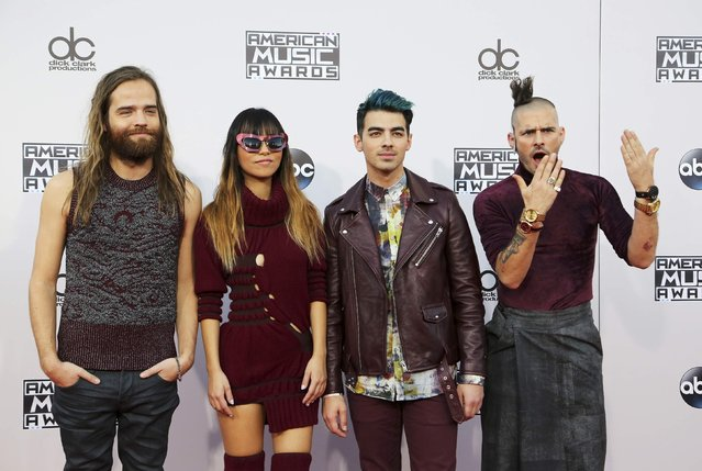 Recording artists Cole Whittle, JinJoo Lee, Joe Jonas and Jack Lawless of the music group DNCE arrive at the 2015 American Music Awards in Los Angeles, California November 22, 2015. (Photo by David McNew/Reuters)