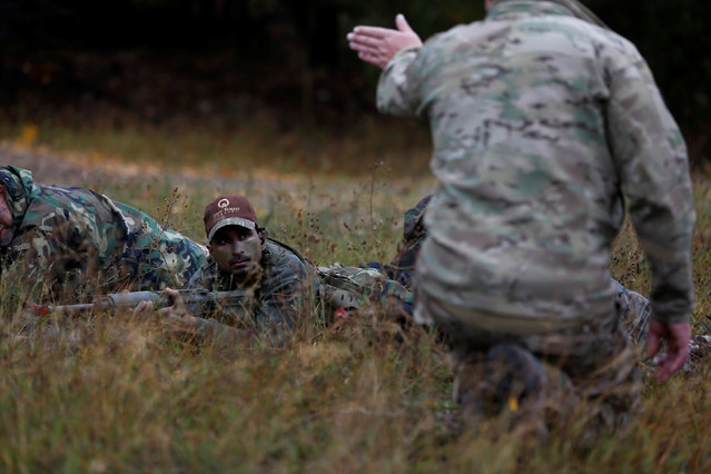Members of the Oath Keepers and general public participate in a tactical training session in northern Idaho, U.S. October 1, 2016. (Photo by Jim Urquhart/Reuters)