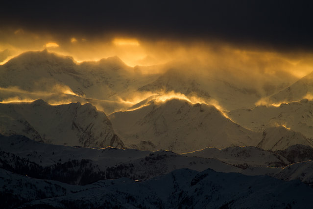 """End of the World"". The picture was taken from Dachstein glacier catching the last sunbeam before the Sun fell behind the Alps. A storm was approaching blowing the snow. If we wanted to show how the World will die, this could have been a proper scene. Location: Dachstein, Austria. (Photo and caption by János Demeter/National Geographic Traveler Photo Contest)"