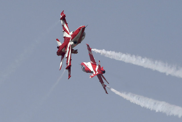 Indian Air Force Suryakiran aircrafts perform an aerobatic maneuver during rehearsals ahead of Aero India 2021 at Yelahanka air base in Bengaluru, India, Tuesday, February 2, 2021. Aero India is a biennial event with flying demonstrations by stunt teams and militaries and commercial pavilions where aviation companies display their products and technology. (Photo by Aijaz Rahi/AP Photo)