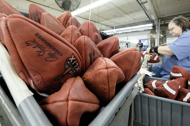 Official game balls for NFL football's Super Bowl XLIX wait to be laced at the Wilson Sporting Goods Co. in Ada, Ohio, Tuesday, January 20, 2015. The New England Patriots face the Seattle Seahawks for the NFL championship on Sunday, Feb. 1, 2015,  in Glendale, Ariz. (Photo by Rick Osentoski/AP Photo)