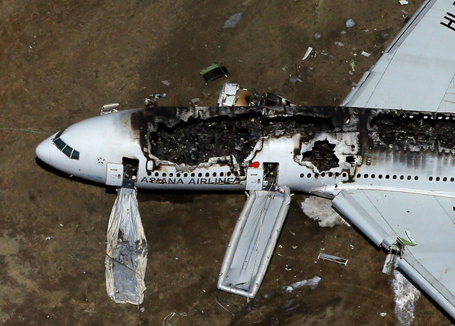 A Boeing 777 airplane lies burned on the runway after it crash landed at San Francisco International Airport July 6, 2013 in San Francisco, California. An Asiana Airlines passenger aircraft coming from Seoul, South Korea crashed while landing. There has been at least two casualties reported. (Photo by Ezra Shaw/Getty Images)