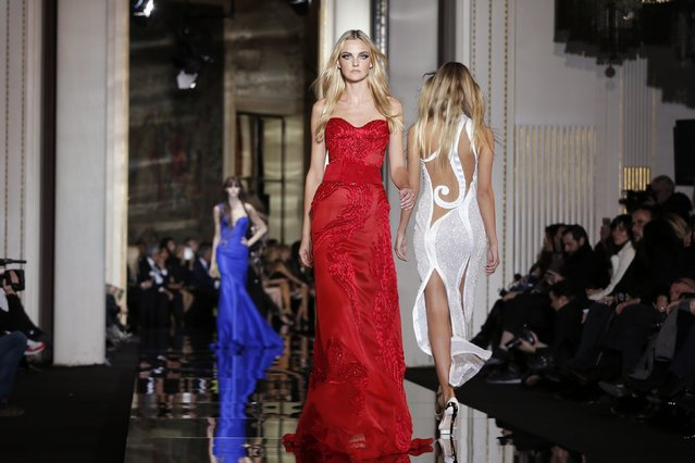 Models present creations by Italian designer Donatella Versace as part of her Haute Couture Spring Summer 2015 fashion show in Paris January 25, 2015. (Photo by Gonzalo Fuentes/Reuters)