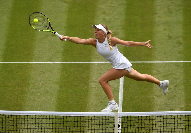 Denmark' s Caroline Wozniacki returns to Russia' s Ekaterina Makarova during their women' s singles second round match on the third day of the 2018 Wimbledon Championships at The All England Lawn Tennis Club in Wimbledon, southwest London, on July 4, 2018. (Photo by Tony O'Brien/Reuters)