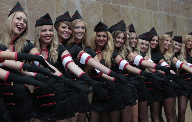 Hostesses pose for a group photo during the Comic Con International convention in San Diego, California July 14, 2012. (Photo by Mario Anzuoni/Reuters)