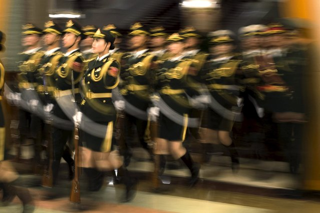 Paramilitary guards arrive prior to the visit of Russian Prime Minister Dmitry Medvedev who meets Chinese Premier Li Keqiang at the Great Hall of the People in Beijing, December 17, 2015. (Photo by Fred Dufour/Reuters)