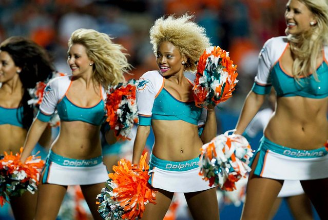 The Miami Dolphins cheerleaders perform during a preseason game against Tampa Bay at Sun Life Stadium in Miami Gardens. (Photo by Allen Eyestone/The Palm Beach Post)