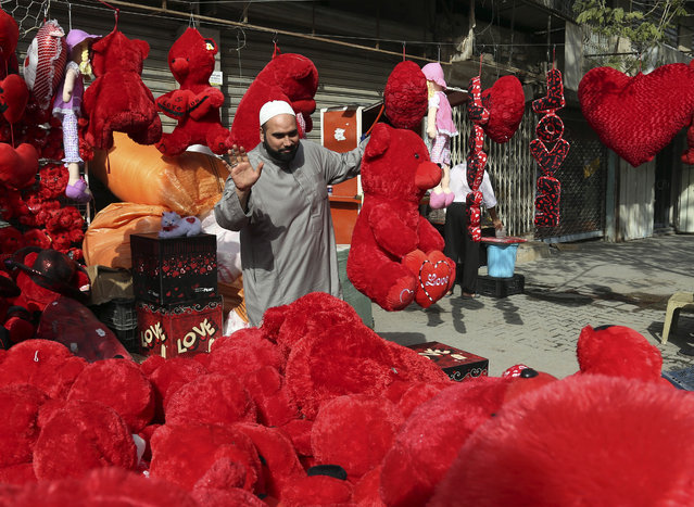 A man shops for gifts ahead of Valentine's Day at the Karrada neighborhood of Baghdad, Iraq, Wednesday, February 11, 2015. Despite violence and harsh circumstances, some Iraqis shop for gifts for their loved ones, marking Valentine's Day. (Photo by Khalid Mohammed/AP Photo)