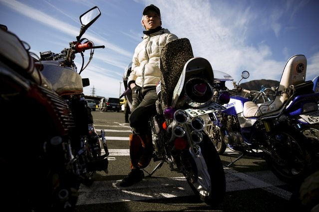 A biker rests against his Bousouzoku style motorbike at the Dangouzaka rest stop in Yamanashi, west of Tokyo, Japan, January 3, 2016. (Photo by Thomas Peter/Reuters)