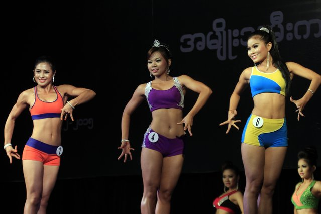 Myanmar female contesters compete during their model physique and fitness physique contest organized by Myanmar bodybuilder Federation at Myanmar Convention Center (MCC) Sunday, February 8, 2015, in Yangon, Myanmar. (Photo by Khin Maung Win/AP Photo)