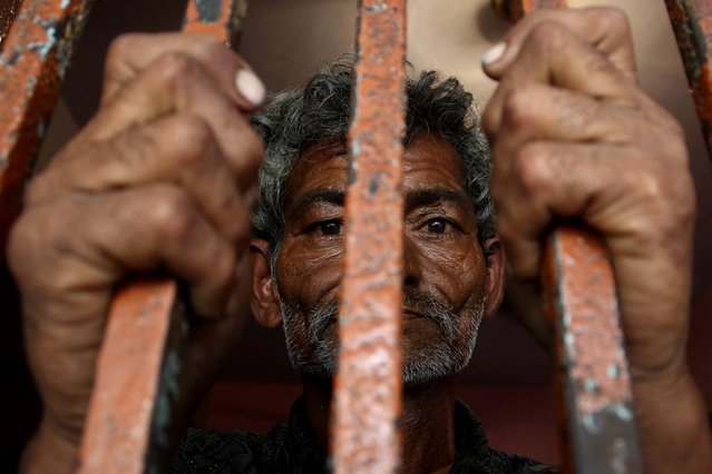 An Indian fisherman stands behind bars after being arrested by the Pakistani authorities, Karachi, Pakistan, 20 November 2016. Pakistani authorities arrested over 43 Indian fishermen in Pakistan's territorial waters on the same day. Pakistan and India regularly arrest the fishermen in the poorly marked territorial waters. They often remain in jail for years before being set free and repatriated. (Photo by Shahzaib Akber/EPA)