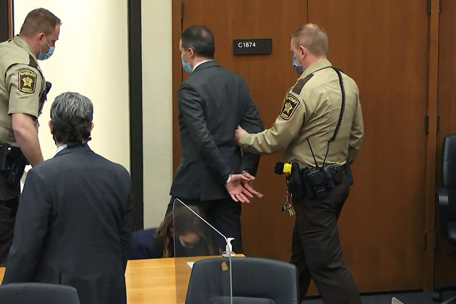 In this image from video, former Minneapolis police officer Derek Chauvin is taken into custody as his attorney Eric Nelson, left, watches, after his bail was revoked after he was found guilty on all three counts in his trial for the 2020 death of George Floyd, Tuesday, April 20, 2021, at the Hennepin County Courthouse in Minneapolis. (Photo by Court TV via AP Photo, Pool)