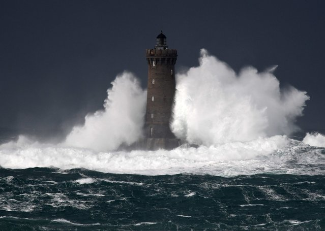 High waves and strong winds hit The Four Lighthouse (Lighthouse of the Four d'Argenton)  at Porspoder, western France on December 27, 2020, as Storm Bella strikes the coast of Britanny. (Photo by Fred Tanneau/AFP Photo/Profimedia)