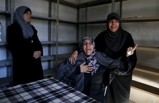 Relatives of Palestinian Srur Abu Srur, who was killed by Israeli army on Tuesday, mourn during his funeral in Aida refugee camp in the West Bank city of Bethlehem January 13, 2016. (Photo by Ammar Awad/Reuters)