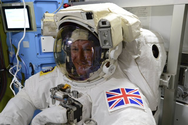 British astronaut Tim Peake poses in his spacesuit aboard the International Space Station on January 11, 2015. Peake became the first astronaut representing Britain to walk in space when he left the International Space Station (ISS) on Friday to fix a power station problem, generating huge interest back in his homeland. (Photo by Reuters/NASA)