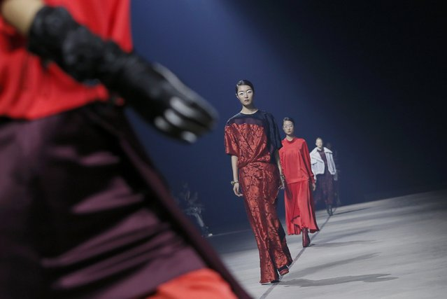 Models present creations by designers Humberto Leon and Carol Lim as part of their Autumn/Winter 2015/2016 women's ready-to-wear collection for Japanese fashion house Kenzo during Paris Fashion Week March 8, 2015.    REUTERS/Gonzalo Fuentes (FRANCE  - Tags: FASHION)