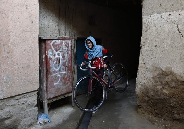 Masooma Alizada, a member of Afghanistan's Women's National Cycling Team walks with her bicycle in Kabul February 20, 2015. (Photo by Mohammad Ismail/Reuters)