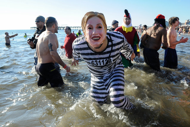 A person wearing a Hillary Clinton mask participates in the annual Polar Bear Plunge in Coney Island in the Brooklyn Borough of New York City, U.S. January 1, 2017. (Photo by Stephanie Keith/Reuters)