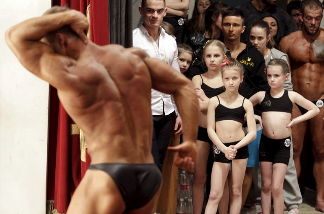 Participants wait backstage during a regional bodybuilding and fitness competition in Stavropol, southern Russia April 4, 2015. More than 100 people from the Stavropol region, Krasnodar, Moscow and other cities competed in several categories, according to organizers. (Photo by Eduard Korniyenko/Reuters)