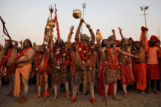 """Naga Sadhus or Hindu holy men arrive to take a dip during the first """"Shahi Snan"""" (grand bath) during """"Kumbh Mela"""" or the Pitcher Festival, in Prayagraj, previously known as Allahabad, India, January 15, 2019. (Photo by Danish Siddiqui/Reuters)"""