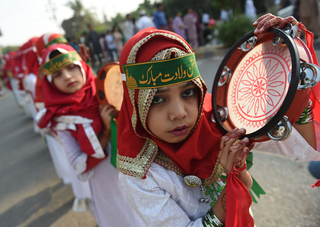 A Pakistani Muslim girl takes part in a rally during Eid Milad- un- Nabi, which marks the birth anniversary of the Prophet Muhammad, in Karachi on November 21, 2018. (Photo by Rizwan Tabassum/AFP Photo)