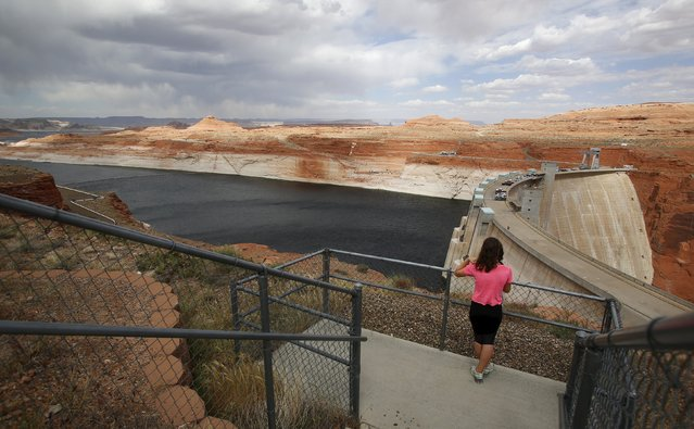 The Glen Canyon Dam can be seen with low water levels of the Colorado River fed Lake Powell outside Page, Arizona, April, 14, 2015. (Photo by Jim Urquhart/Reuters)