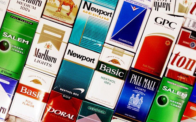 This Wednesday, September 14, 2005 file photo shows cigarette boxes in a store in Brunswick, Maine. On Jan. 11, 1964, U.S. Surgeon General Luther Terry released an emphatic and authoritative report that said smoking causes illness and death – and the government should do something about it. (Photo by Pat Wellenbach/AP Photo)