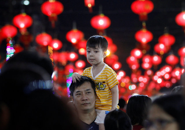 A boy sits on his father's shoulders as they visit the Chinese Lunar New Year's festival in Chinatown, in Yangon, Myanmar January 27, 2017. (Photo by Soe Zeya Tun/Reuters)