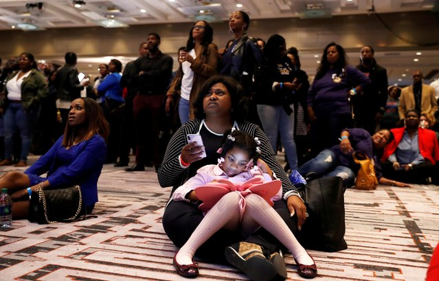 Deidre Brown Collins holds her daughter, Vitalia Collins, as they watch returns during a midterm election night party for Georgia Democratic gubernatorial nominee Stacey Abrams in Atlanta, Georgia, U.S., November 6, 2018. Abrams narrowly lost to Brian Kemp in her effort to become the nation's first female African-American governor. (Photo by Leah Millis/Reuters)
