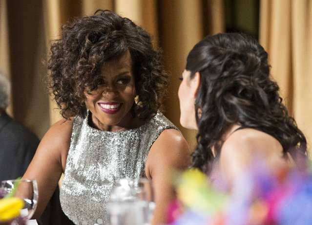 First lady Michelle Obama mingles during the White House Correspondents' Association dinner at the Washington Hilton on Saturday, April 25, 2015, in Washington. (Photo by Evan Vucci/AP Photo)