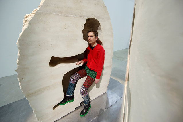 """French artist Abraham Poincheval poses inside his artwork """"Pierre"""" (""""Stone"""") in Paris, France, February 2, 2017 as he presents his upcoming project, living inside a rock for a week from February 22. (Photo by Benoit Tessier/Reuters)"""