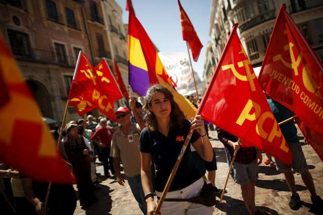 People wave a second Spanish Republic flag (C) and Communist flags during a May Day rally in Malaga, Spain May 1, 2015. (Photo by Jon Nazca/Reuters)