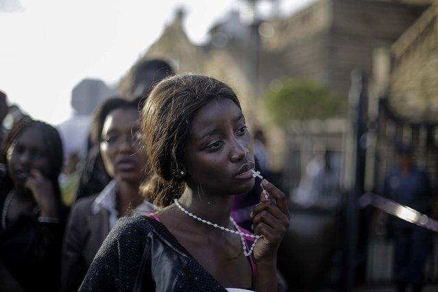 1st prize in the People Observed Portraits Single category. Markus Schreiber, Germany, for The Associated Press. The photo shows a woman reacting in disappointment after access to see former South Africa President Nelson Mandela was closed on the third and final day of his casket lying in state, outside Union Buildings in Pretoria, South Africa, December13, 2013. (Photo by Markus Schreiber/World Press Photo)