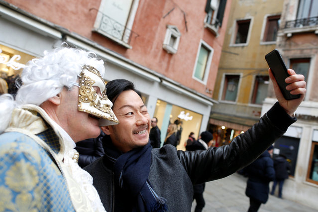 A tourist takes a selfie with a masked reveller during the Venice Carnival in Venice, Italy February 11, 2017. (Photo by Tony Gentile/Reuters)